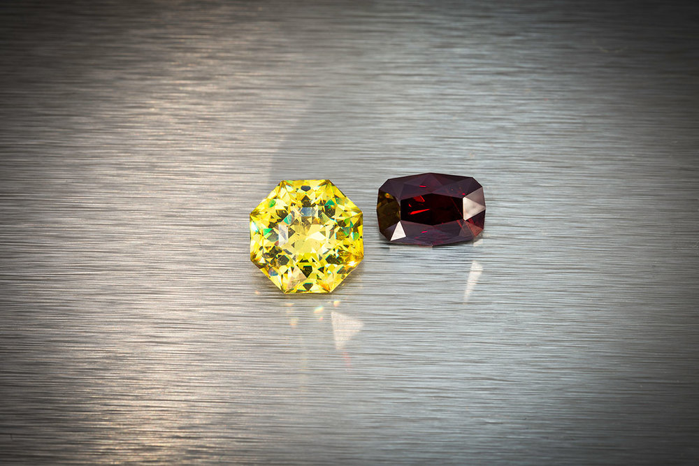 Cousins. Left, sphalerite from Spain, 11.34 ct., 12.8 x 12.8 x 8.5 mm. Right, rare wurtzite from Mahenge, Tanzania, 5.81 ct., 12.4 x 8.3 x 6.2 mm. Both of these stones were custom cut by Brett Kosnar. Prices available upon request.(Photo: Mia Dixon)