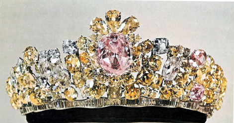 """Nur ul-Ain  (Light of the Eye) Tiara.  One of the more modern creations in the royal collection, this tiara was the second created by Harry Winston for the Pahlavi wedding in 1958. Meen and Tushingham speculate (139) that the central rose-pink diamond (est. 60 ct), along with the Darya-i Noor (pictured below) might have formed a single stone, which Tavernier called the """"Great Table."""""""