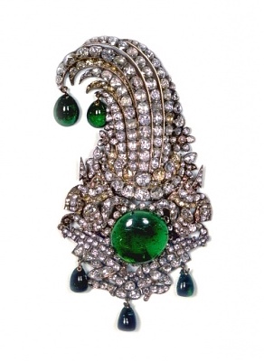 Nader Shah Jiqa.  This is just one example of the several  jiqa s, or aigrettes, in the collection, which decorated turbans or other headdresses. Its central emerald is estimated at 65 carats.