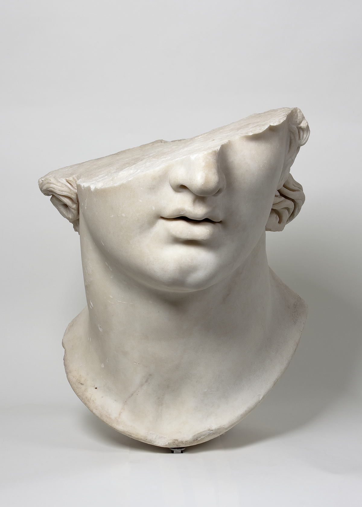 Fragmentary Colossal Head of a Youth.  Greek, Hellenistic period, 2nd century B.C.E. Marble. H. 22 7/8 in. (58 cm). Antikensammlung, Staatliche Museen zu Berlin (AvP VII 283). (Image: © SMB / Antikensammlung)