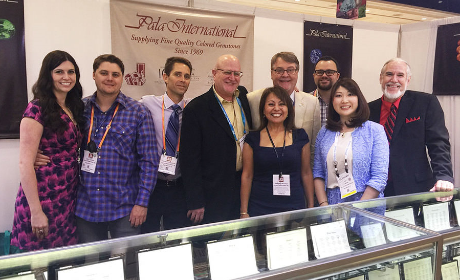 """And many more… Pala International celebrates its 47th birthday on June 26. A perennial joy of this business is meeting our clients face-to-face at trade shows such as this month's AGTA GemFair in Las Vegas, above. From left:Alison Collins, Carl Larson, Jason Stephenson, Richard Hughes (of Lotus Gemology), Gabrièl Mattice, Bill Larson, Will Larson, Rika Larson, Josh Hall.   May 16 marked Gabrièl's 28th year with Pala International, but also the herald of her departure. We wish her well as she moves on to other pursuits. (See  """"Gabrièl Mattice Takes Her Golden Ticket""""  below for more on her career at Pala.)  And since we're marking milestones, we should mention that February 24 of this year was the 16th birthday of Palagems.com, launched by Richard Hughes when he was on the Pala International staff."""