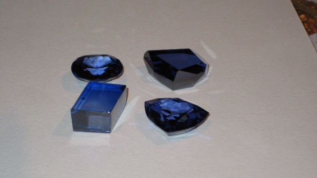 During a private tour of the Paris museum's holdings, Gabrièl, Jeanne Larson, and Kate Donovan were treated by the curator of minerals, François Farges, to a view of lead glass models depicting the different stages of cutting the famous French Blue (about which, more below).