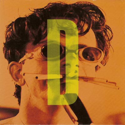 Mark Mothersbaugh, with glasses, on the cover of a DEVO compilation.