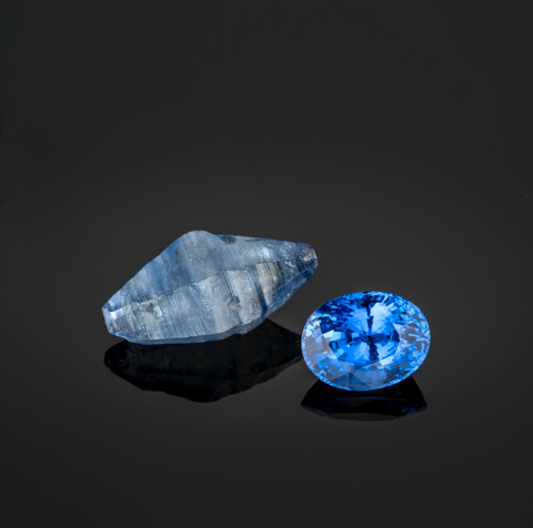 Flat blue sapphire crystal, 25 mm, and Sri Lankan cushion cut sapphire, 11.67 carats.