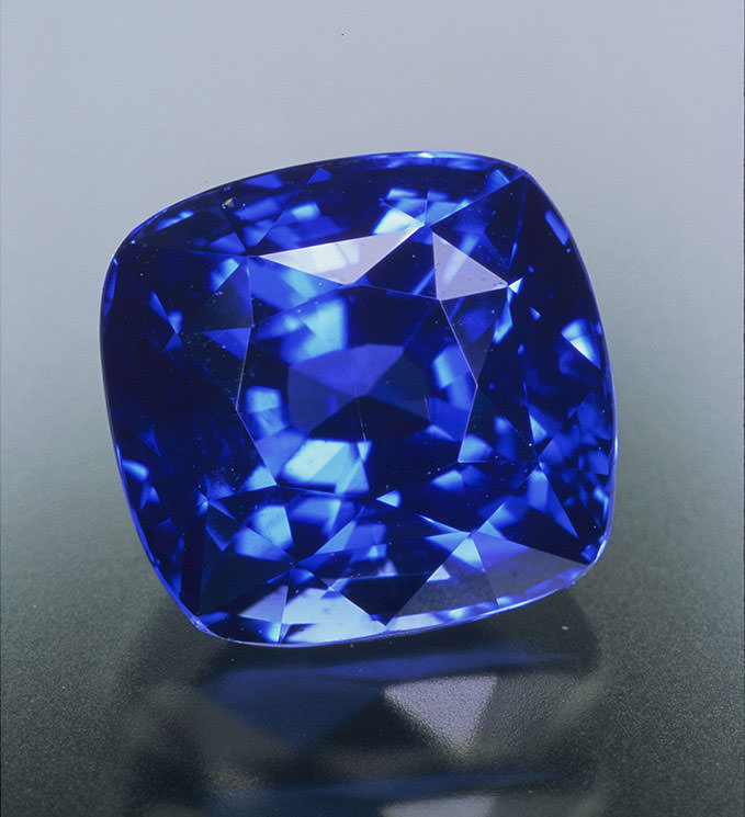 Blue sapphire is often deep and dark. This 2.05-carat Ceylon sapphire exhibits fine color and exceptional transparency, diaphaneity or crystal. (Photo: Jeff Scovil, courtesy R. W. Wise, Goldsmiths)