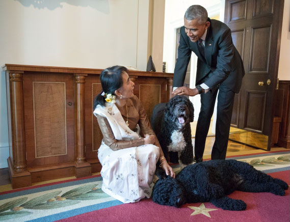 Above, the White House Photo of the Day. President Barack Obama and Aung San Suu Kyi, State Counsellor and Minister of Foreign Affairs of Myanmar, visit with Obama family pets Bo and Sunny in the Cabinet Room of the White House following their bilateral meeting, Sept. 14, 2016. (Official White House Photo by Pete Souza)