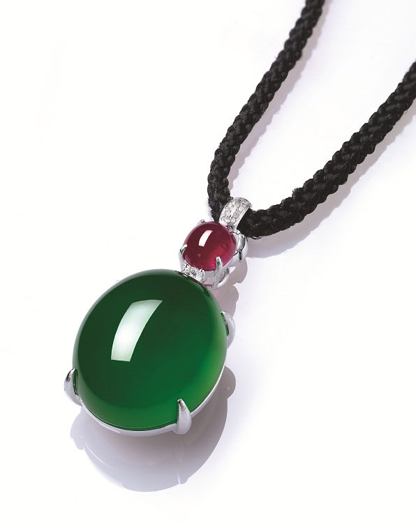 """From the CNN  slide show , a jadeite cabochon, ruby and diamond pendant necklace, offered by Christie's Hong Kong in June 2015 with a pre-sale estimate of US$3.5 to 4.8 million. It   did  sell , for nearly US$5.7 million, setting a world record for a single jadeite cabochon. Want to see more images? See  """"Colors of the Rainbow""""  from the  New York Times , May 2015. (Photo: Christie's press image)"""