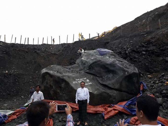 Shoulder to shoulder boulder beholders.  Local politician U Tint Soe stands before the giant jade.(Photo: Shan Kyi / Facebook)
