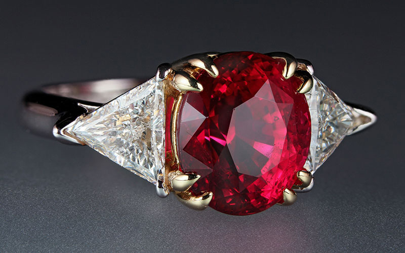 A 6.07-carat ruby in platinum and 18-karat gold ring, flanked by two triangular diamonds, approximately 1.50 carats. From the Cora Miller Collection. (Photo: Harold Moritz, courtesy of Yale Peabody Museum)
