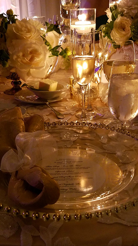 Chargers double as menus at the wedding dinner. We count three glasses, not including water… (Photo: Mia Dixon)