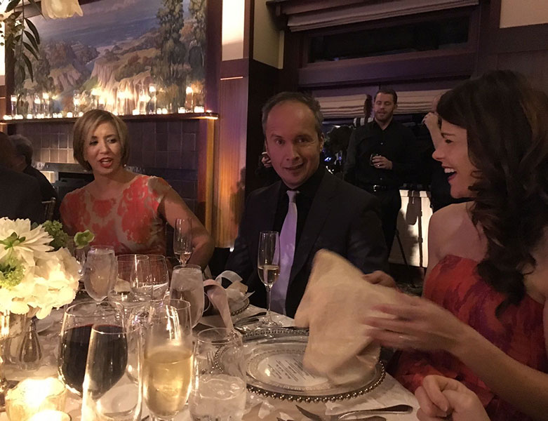 Luminaries in the gem and mineral world: (from left) GIA Museum exhibit developer McKenzie Santimer, Gem-A CEO Alan Hart, and Raquel Alonso-Perez, Curator of the Mineralogical and Geological Museum, sit down to dinner. (Photo: Patrick Dreher)