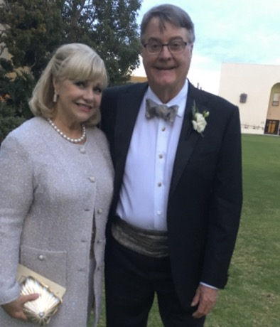 Jeanne and Bill Larson, parents of the groom, outside the chapel. (Photo: Brendan Laurs)