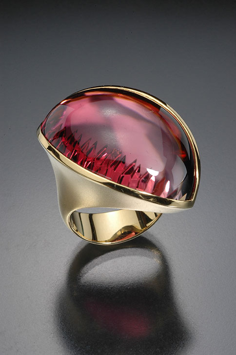 Tourmaline.  A beautiful ring featuring a stone faceted in its distinctive style by the famous Atelier Tom Munsteiner of Idar-Oberstein. From the Cora N. Miller Collection. (Photo: Jeff Scovil, courtesy R. W. Wise, Goldsmiths)