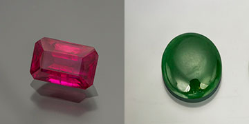 The Holly and the Ivy:  Pala International's colors of the season are represented by a 1.83-ct heated emerald-cut Burma ruby (Inv.  #23118  with an AGL cert) along with an 8.19-ct Burma jadeite cabochon (Inv.  #23164  with a GIA cert). (Photo: Mia Dixon)