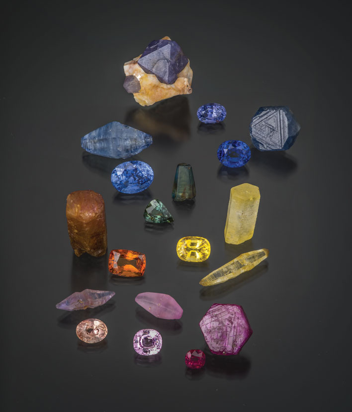 Treasures of the Earth.  From the book's introductory pictorial: Natural rubies and sapphires from around the world, including Madagascar, Myanmar, Pakistan, Sri Lanka and Tanzania. Crystals range from 14–25 mm in size; cut stones from 2.72–15.20 ct. (Photo: Robert Weldon; specimens: William Larson collection)