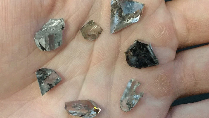 Assortment of diamond offcuts used in the study. The largest is 9.6 carats. These diamonds could be analyzed by destructive means (polishing to expose inclusions) whereas many other diamonds studied were polished gemstones that were only borrowed and studied non-destructively. (Photo: Evan Smith; © GIA)