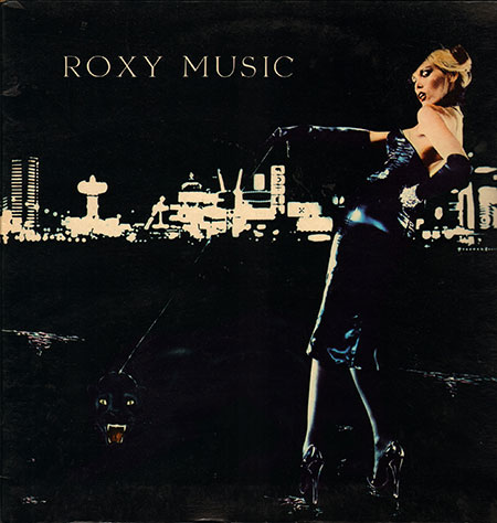 """For whose pleasure? Cover star Amanda Lear walks (barely), with a black cat on one arm, a diamond cuff on the other. ( Click for the full gatefold cover, including Ferry posing as a grinning limo driver.) Author David Buckley quotes Brian Eno as saying he personally would have preferred a straightforward image of the band on the cover. Then, somewhat contradictorily, """"It's all becoming too stereotyped,"""" he said, after only two years. Eno left Roxy after this album, his object being """"to eliminate himself from his work…,"""" according to Simon Frith and Howard Horne, """"to cleanse his art of the idea of the individual artist""""—the antithesis of Ferry-as-frontman."""