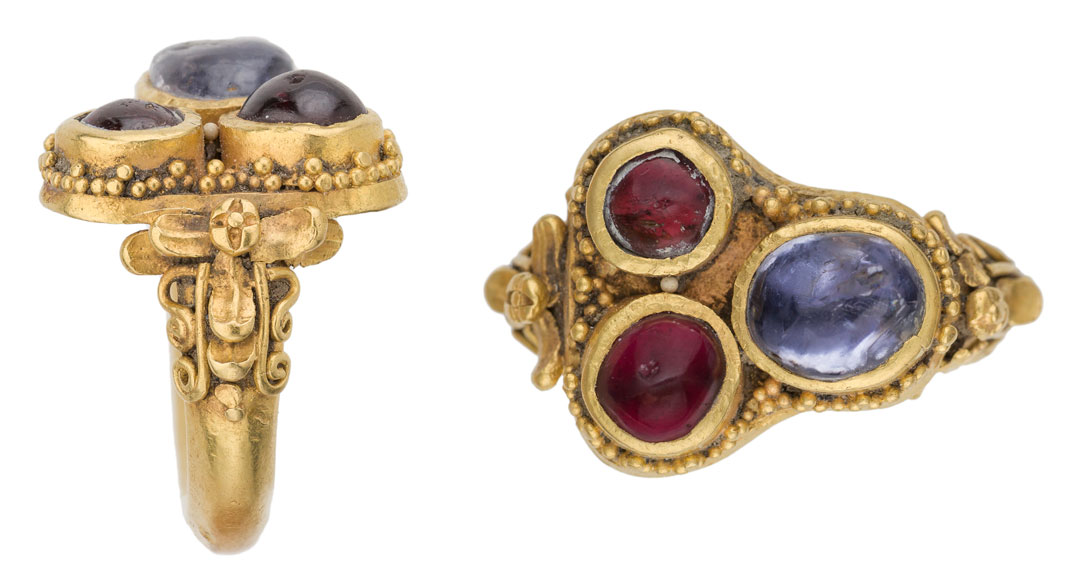 Ring (2 views).  Heavy gold ring set with its original cabochon gems, one blue sapphire and two rubies. Java, 9th–10th century. Wt. 14.9 g; 22.1 x 24.6 x. 15.8 mm. D. Content,  Ruby, Sapphire & Spinel: An Archaeological, Textual and Cultural Study. Part II: The Babar-Content Collection  (Turnhout 2016), 94–95 pls [unnumbered] no. 32. (Photos: Gonzalo Salcedo)