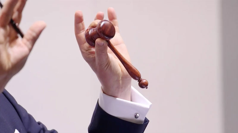 """""""Use your hands,"""" advises Hugh Edmeades, who has racked up over £2.2 billion in sales at Christie's, in this moment from  'A performance art': The secrets of a Christie's auctioneer .One secret left untold: why the gavel is so rarely held by its handle."""