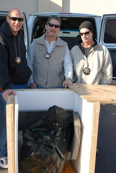 Cops and robbed?  Scott Miller, Mark Gayman, and Lt. Tom Grub, of the Los Angeles Sheriffs Department, show off the swag in 2008. (Photo: L.A. Sheriffs Dept.)