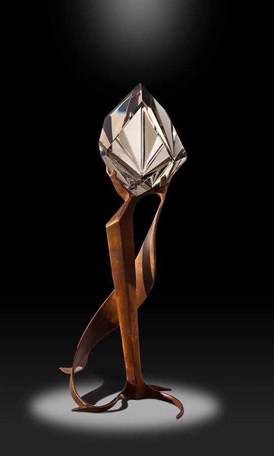 "Art of Dance ,carved optical citrine on bronze base, 13"" h. (Photo:Gary Alvis)"