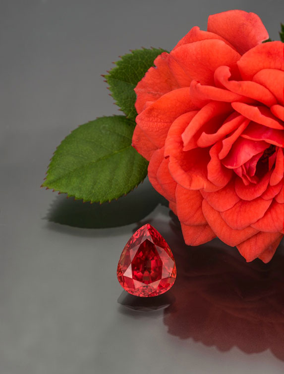 Pear-shaped 5.65-carat natural padparadscha sapphire from Malawi, 12.08 x 9.80 x 6.34 mm with AGL certificate. (Photo: Mia Dixon)