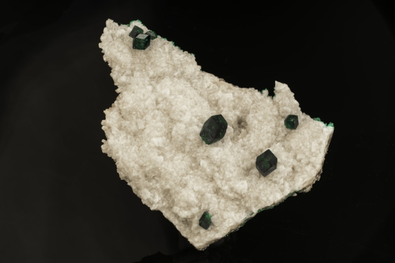 Dioptase from the Tsuemb Mine, Namibia measuring 12 x 8.5 x 2.5 cm. (Photo: Mia Dixon)
