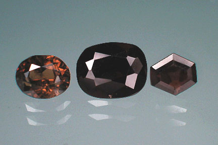 Dark red beauties:  Painite, with a hardness of 8 on the Mohs' scale, has been quite elusive, with only three known specimens collected between 1954 and 2000. Faceted painites are even rarer; the above stones are amongst the very few painites considered to be clear enough for cutting. Weight (l-r): 0.72 cts, 1.32 cts, 0.32 cts. (Photo: Wimon Manorotkul)