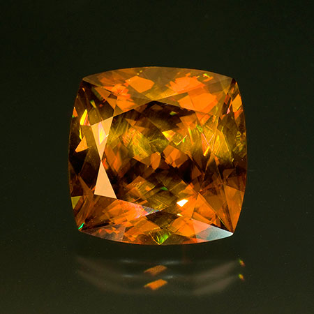 Golden brown sphene. This stone weighs 40.33 carats and measures 20.03 x 20.05 x 12.86 mm. Inventory  #18755 . (Photo: Jason Stephenson)
