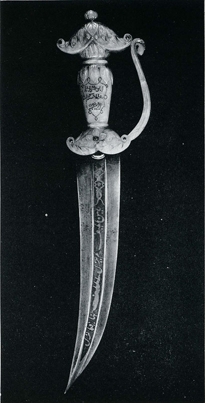 """A Moslem Dagger.  The Persian blade of Damascus steel is set in a jade hilt embellished with rubies by Hindu craftsmen, and is inscribed in Arabic rimed porse [prose]: """"Thanks be to Allah. Praise be to Allah. Patience is of Allah.""""(Drummond Collection, A.M.N.H. Photo by Julius Kirschner)"""