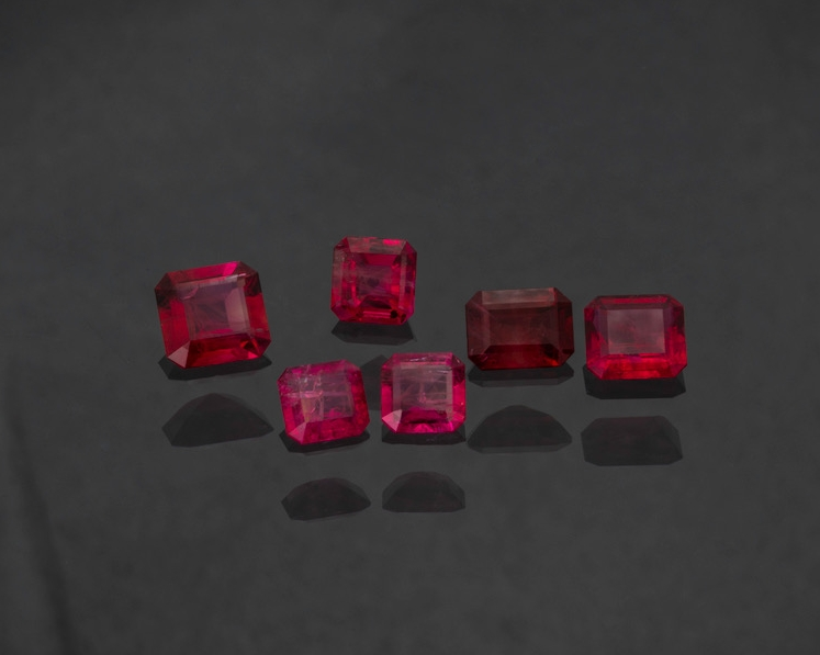Red beryl - Back Row: 0.87 cts, 0.64 cts, 0.71 cts, and 0.67 cts. Front, Matched Pair: 0.85 ctw. (Photo: Mia Dixon)