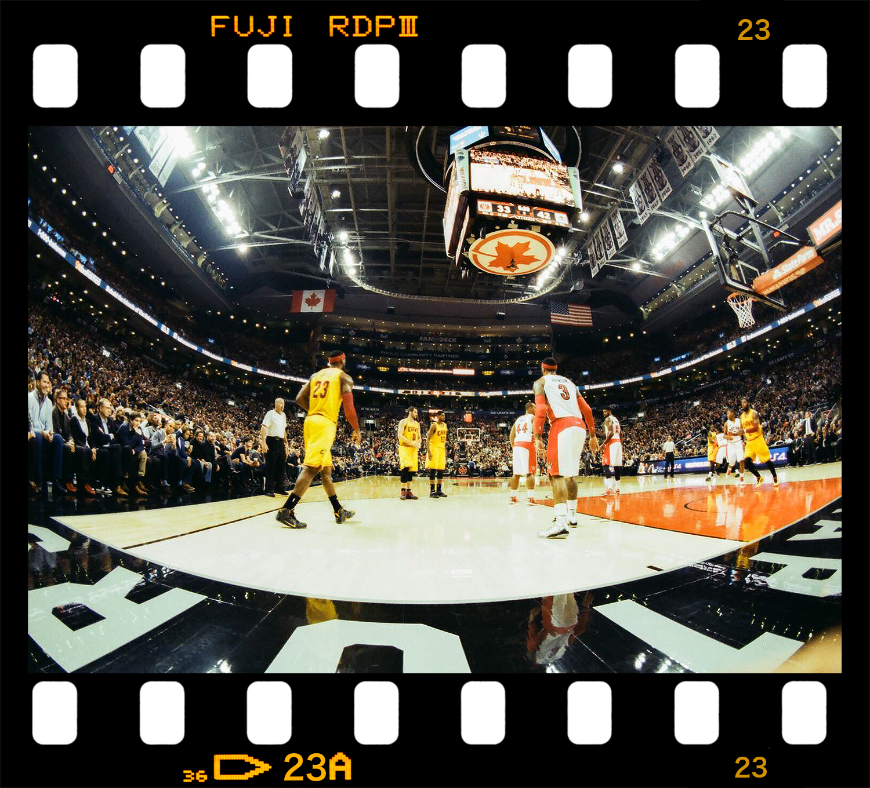 3Bphoto_NBAPhotographer_ClevelandCaveliers_TorontoRaptors_LBJ_TheKing_KingJames_LebronJamesLayup_Photography_LebronDrivingVSJamesJohnson-Jumpshot-Air-Canada-Centre-Fisheye-Lens-Film-Kodak-Gold.jpg