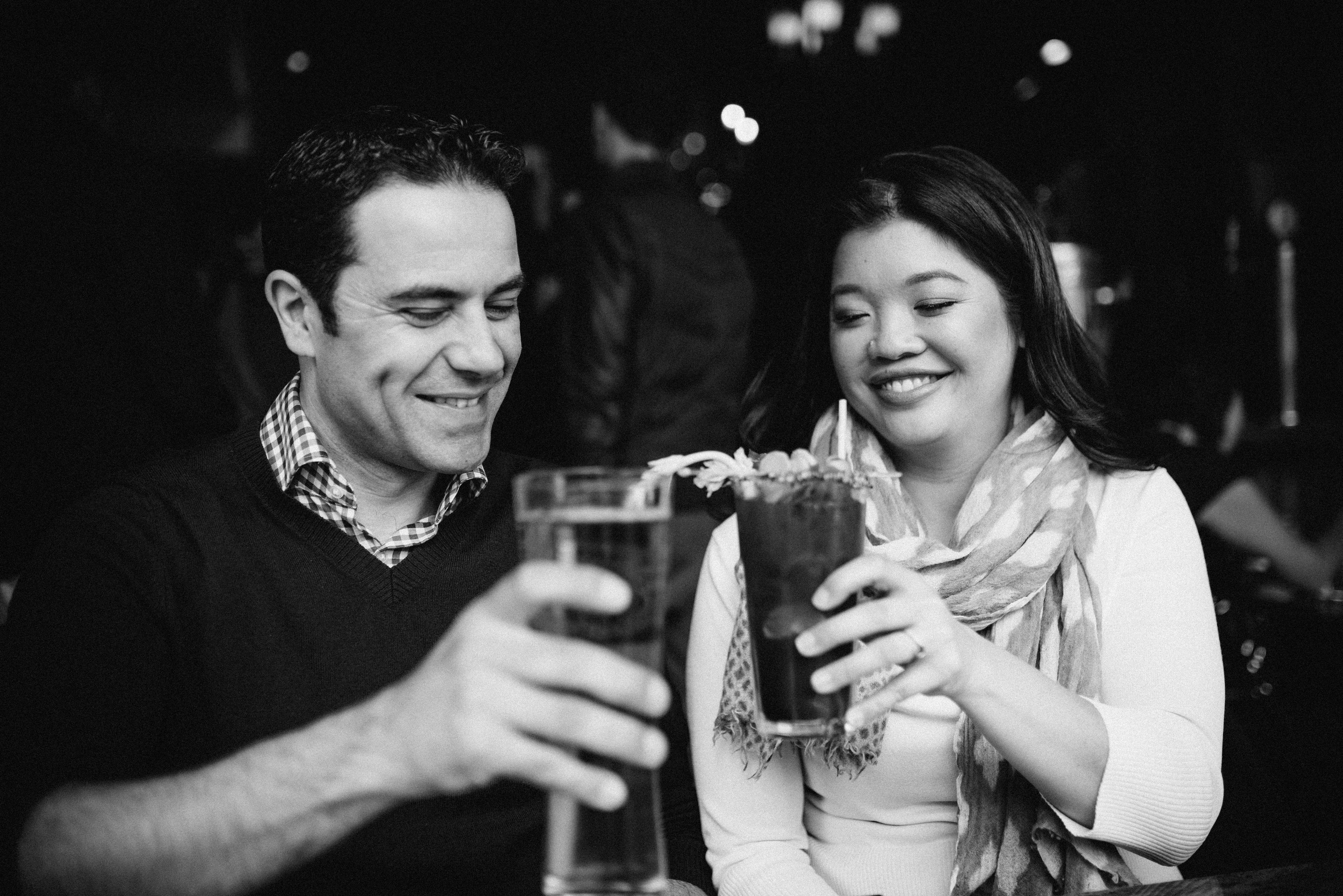 Candid of couple getting drinks in Leslieville, Toronto