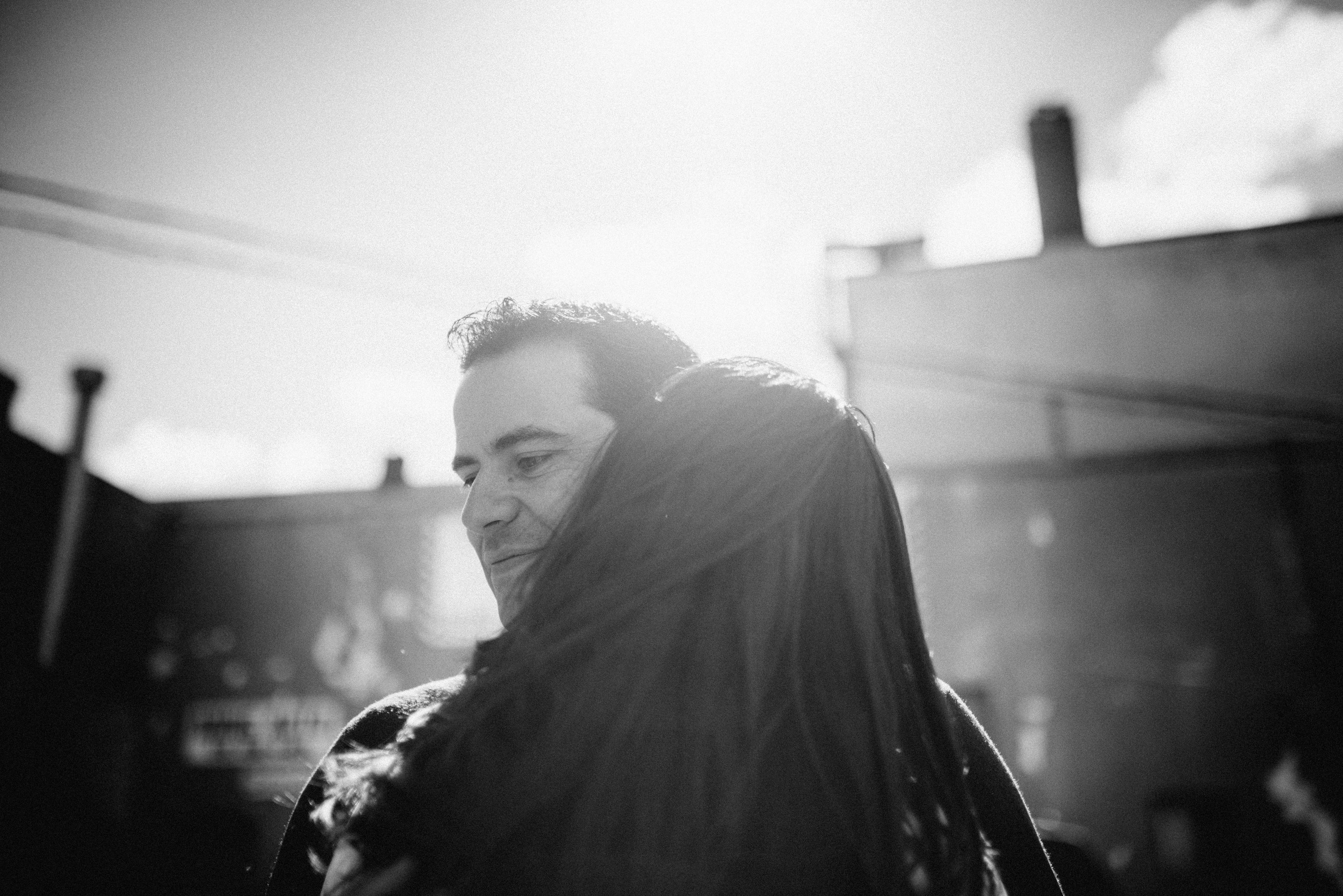 Mike embracing his fiance during photojournalist engagement shoot