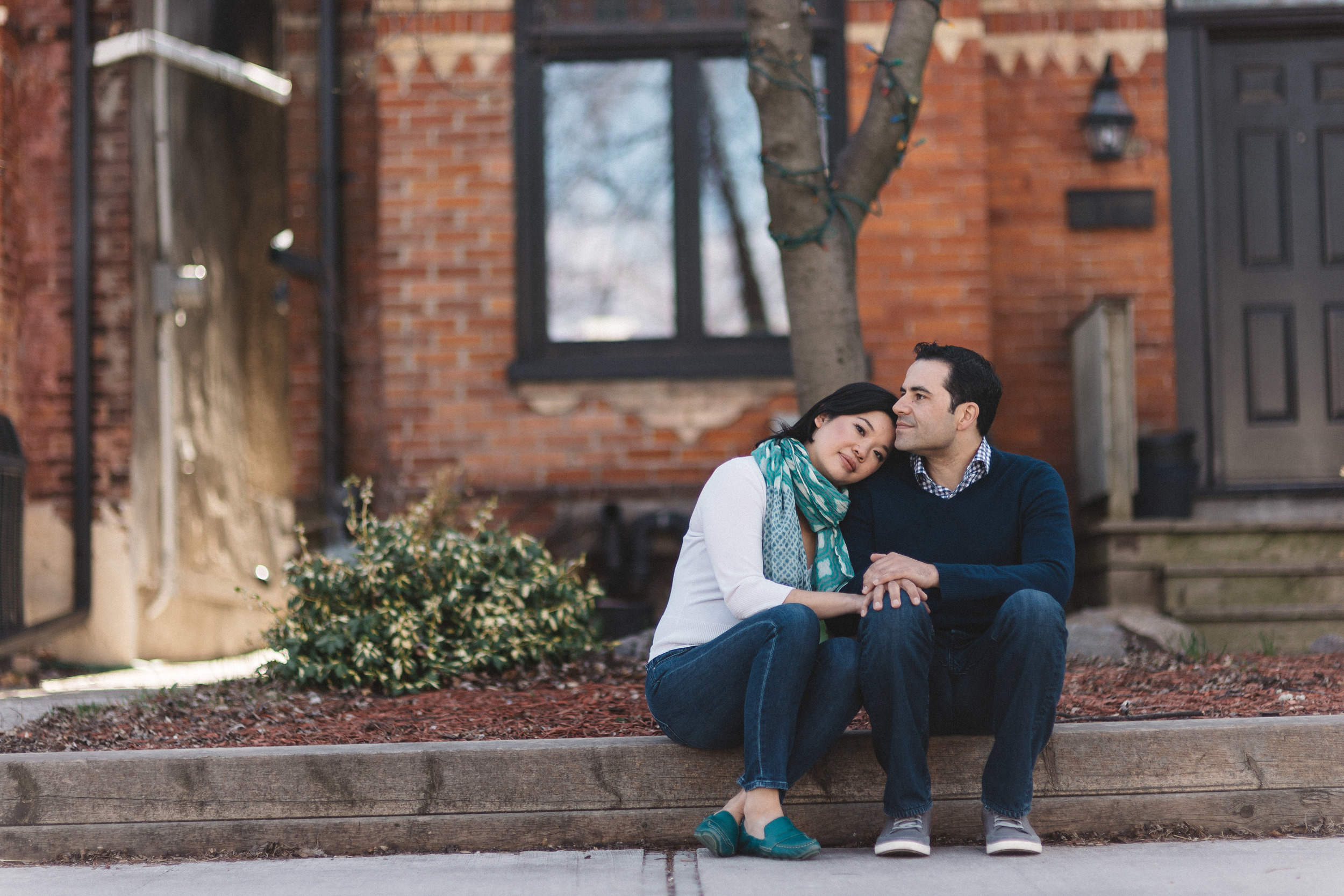 Engagement photo on the sidewalk