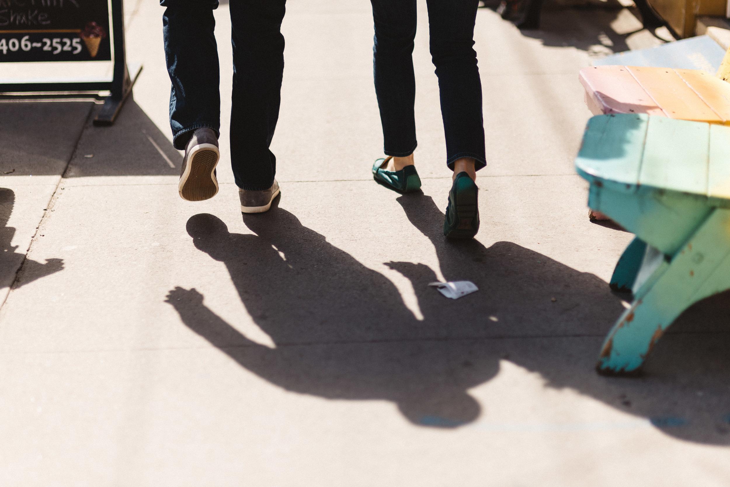 Couple walking down busy Toronto street, GTA