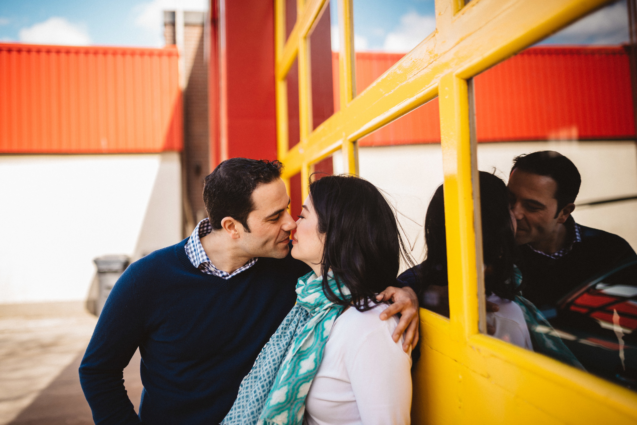 Couple kissing at engagement shoot before wedding