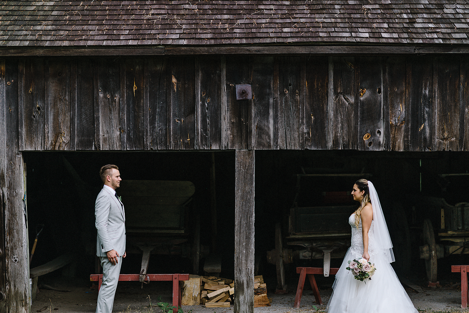 Toronto Ontario wedding photographer 3B Photography at Black Creek Pioneer Village intimate wedding portrait of groom and bride in a vintage rustic barn