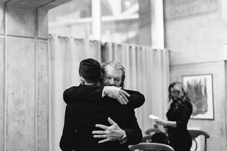 Best-Toronto-Wedding-Photographers-Fine-Art-Documentary--Photography-Candid-Photojournalism-Intimate-Toronto-City-Hall-Elopement--Fall-Wedding-Photography-Artistic-Intimate-City-Hall-Elopement-Father-Hug.jpg