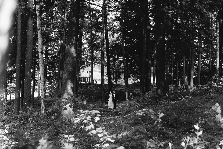 Toronto-Wedding-Photographer-Muskoka-Wedding-Lakeside-Forest-Theme-Boho-Bride-Wedding-Walking-Down-the-Aisle.jpg