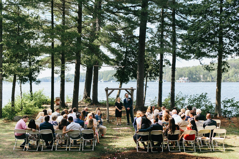 Toronto-Wedding-Photographer-Muskoka-Wedding-Lakeside-Forest-Theme-Boho-Bride-Vintage-wedding-dress-detail-ceremony-waiting.jpg
