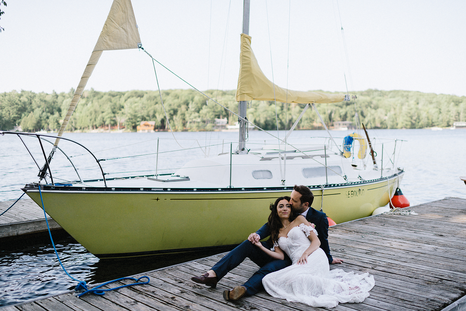 Muskoka-Cottage-Wedding-Photography-Photographer_Photojournalistic-Documentary-Wedding-Photography_Vintage-Bride-Lovers-Land-Dress_Rue-Des-Seins_Forest-Ceremony-Bride-and-Groom-Intimate-moment-on-Sailboat.jpg