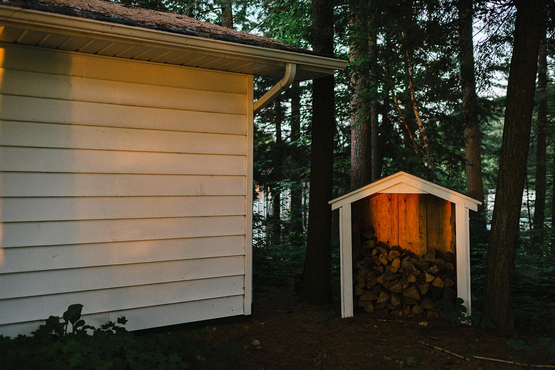 Muskoka-Cottage-Wedding-Photography-Photographer_Photojournalistic-Documentary-Wedding-Photography_Lakeside-Ceremony-Sunset-Light-on-Trees-and-Home.jpg
