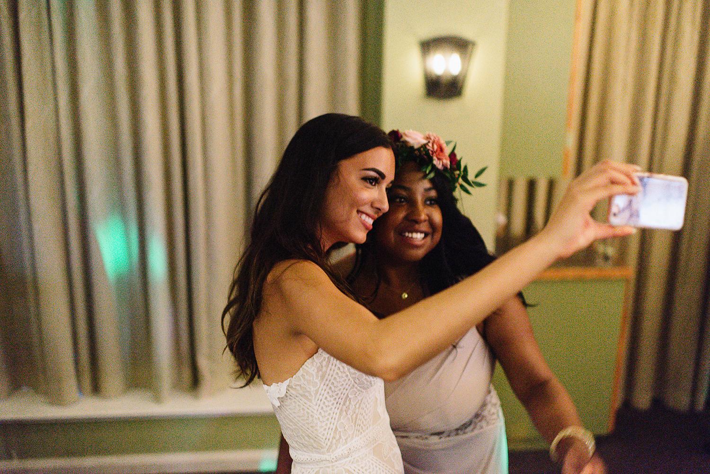 Muskoka-Cottage-Wedding-Photography-Photographer_Photojournalistic-Documentary-Wedding-Photography_Vintage-Bride-Lovers-Land-Dress_Boho-Bride-Wedding-Reception-Selfie-Candid-Detail.jpg
