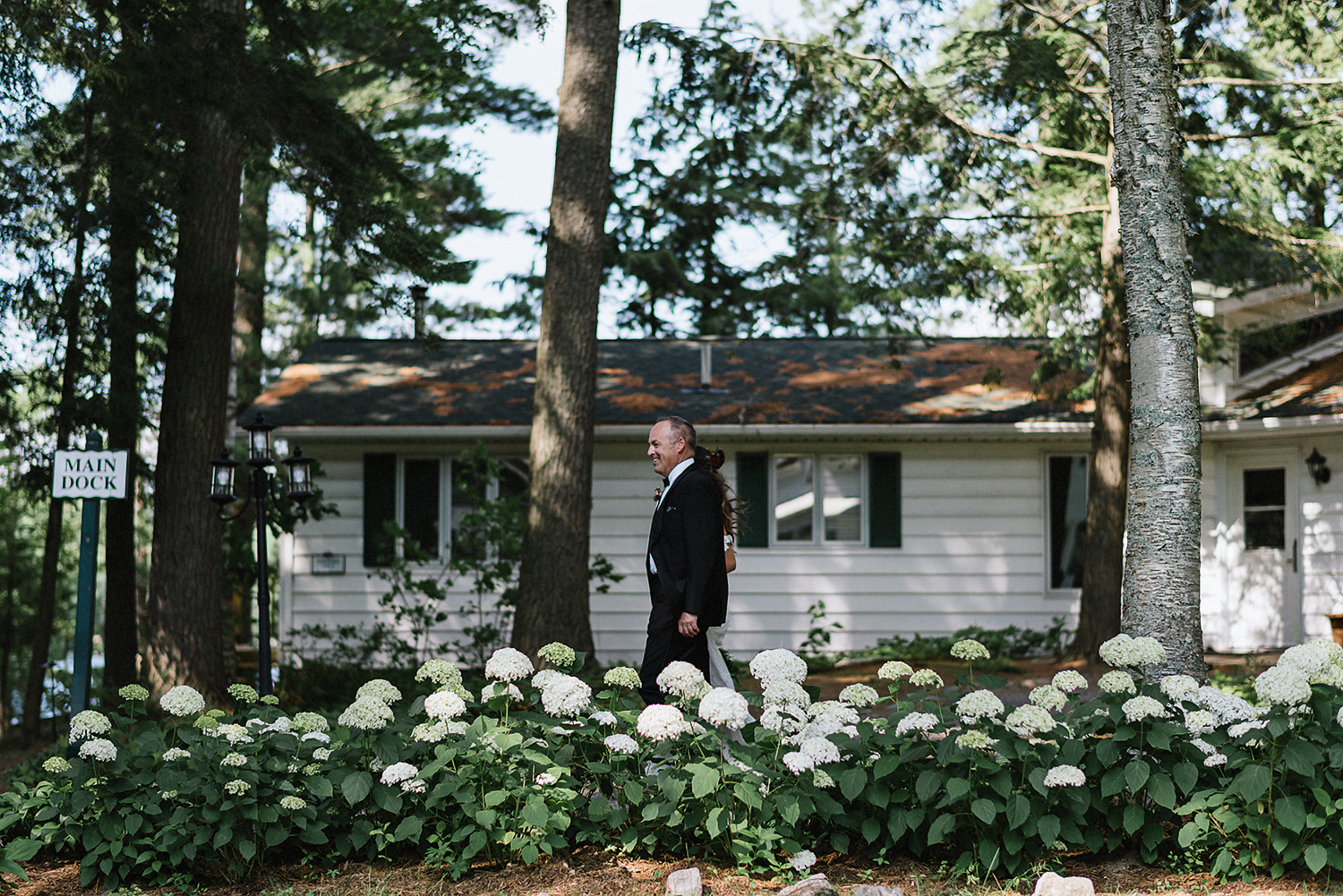Muskoka-Cottage-Wedding-Photography-Photographer_Photojournalistic-Documentary-Wedding-Photography_Vintage-Bride-Lovers-Land-Dress_Rue-Des-Seins_Forest-Ceremony-Bride-and-father.jpg
