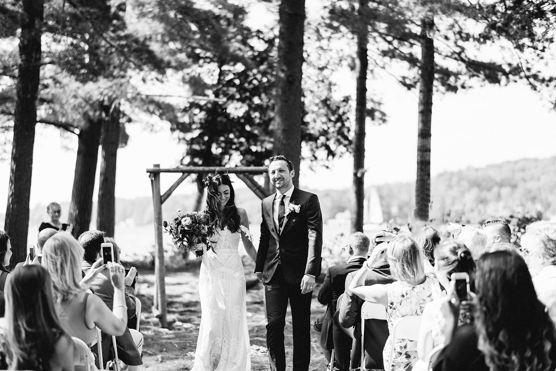Muskoka-Cottage-Wedding-Photography-Photographer_Photojournalistic-Documentary-Wedding-Photography_Vintage-Bride-Lovers-Land-Dress_Bride-Groom-Exit-Forest-Ceremony.jpg