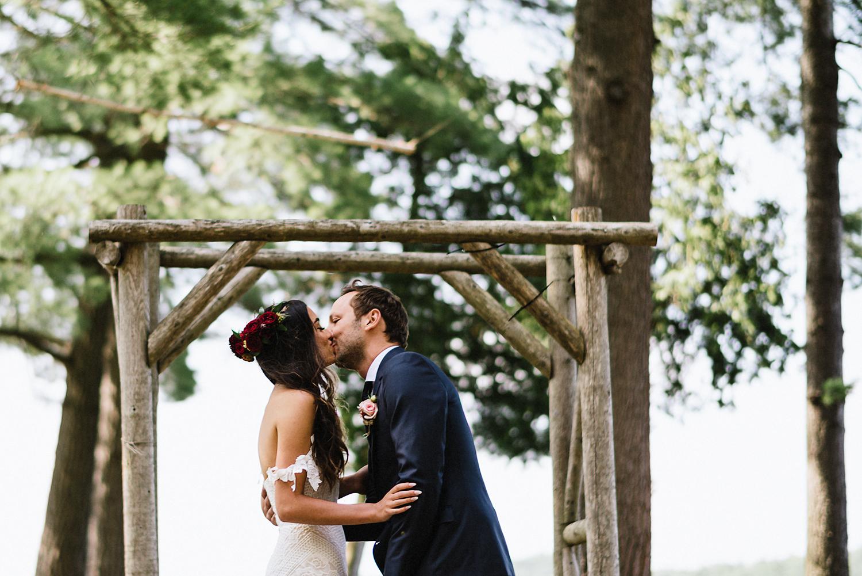 Muskoka-Cottage-Wedding-Photography-Photographer_Photojournalistic-Documentary-Wedding-Photography_Vintage-Bride-Forest-Wedding-Ceremony-Venue-First-Kiss-Bride-and-Groom.jpg