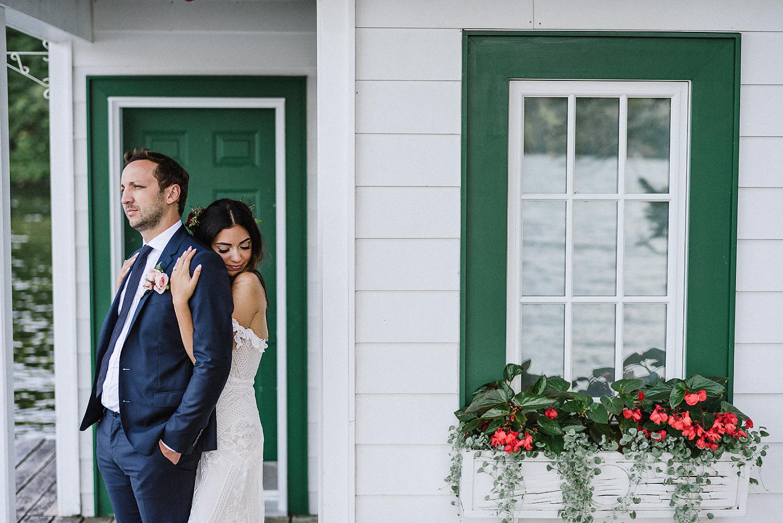 Muskoka-Cottage-Wedding-Photography-Photographer_Photojournalistic-Documentary-Wedding-Photography_Vintage-Bride-Lovers-Land-Dress_Rue-Des-Seins_Bridal-Portrai-Boho-Bride-and-groom-with-lakehouse.jpg