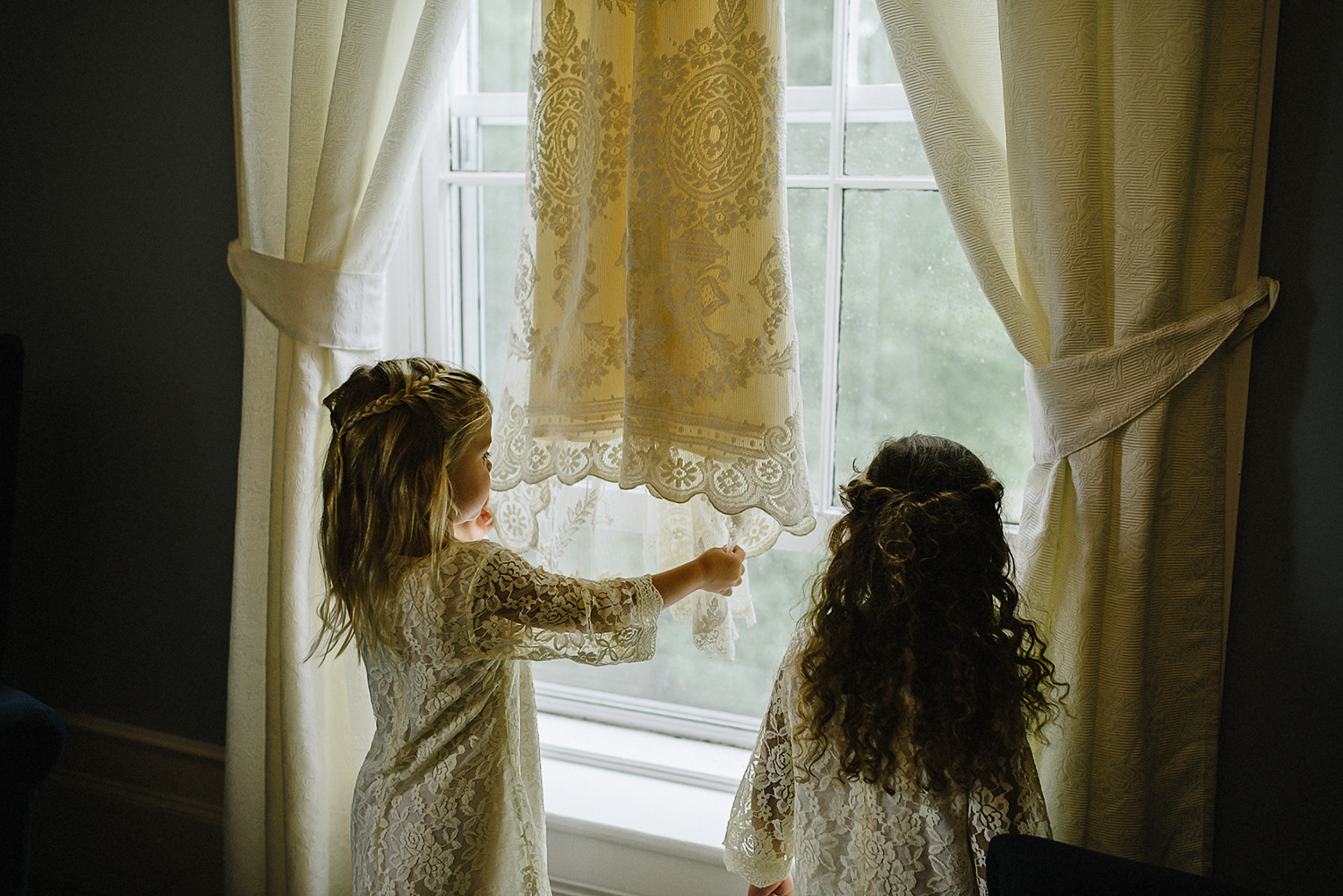 Best-Moody-Documentary-Wedding-Photography-Vintage-Small-Town-Chapel-Wedding-Toronto-Ontario_Flowr-Girls--playing-with-bride-dress.jpg