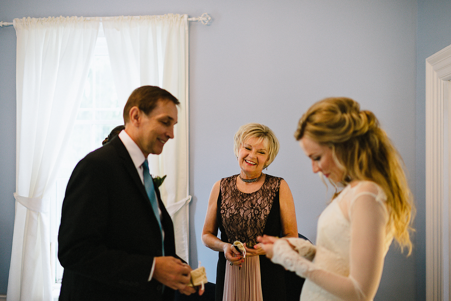 Best-Moody-Documentary-Wedding-Photography-Photojournalism-Vintage-Small-Town-Chapel-Wedding-Toronto-Ontario_Candid-Bride-and-Parents-candid-moment.jpg